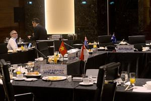 Delegates chat after a gathering of Trans-Pacific Partnership member countries in Hanoi on May 21, 2017.