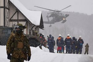A helicopter from Japan's Self-Defence Force at a ski resort during a rescue operation after the volcanic eruption of Mount Kusatsu Shirane in Kusatsu, Gunma, Japan, on Jan 23, 2018.