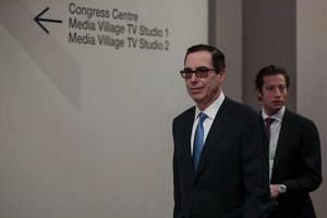 Mnuchin departs a press briefing on day two of the World Economic Forum, Jan 24, 2018.
