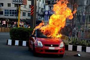 A car burns after allegedly been set on fire by Rajput community members during a protest against the release of Bollywood movie Padmavat, in Bhopal, India, on Jan 24, 2018.