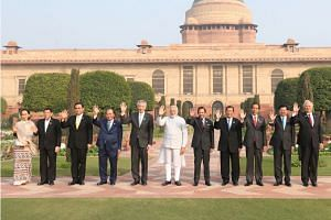 Prime Minister Lee Hsien Loong at the Mughal Gardens of Rashtrapati Bhavanwith - the official residence of the President of India - in New Delhi with (from left) Myanmar's State Counsellor Aung San Suu Kyi; Philippine President Rodrigo Duterte; Thai