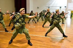 The guards going through baton strike and jab techniques during the exercise.