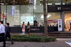 Machine-human promotional interactions, such as KT Corporation's interactive signage, appeal to millennials and digital natives.