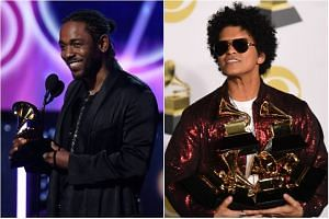 On an evening when many turned up with white roses to support women's equality and freedom from sexual harassment, the thunder was stolen by funk revivalist Bruno Mars (right) and rapper Kendrick Lamar.