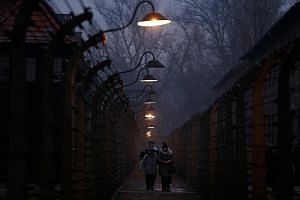 Survivors and guests at the former Nazi death camp of Auschwitz. A diplomatic row between Poland and Israel brewed over a new Bill passed by Poland as the world marked International Holocaust Remembrance Day on Saturday.