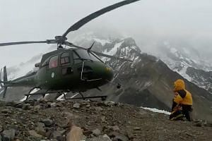 A Pakistani military helicopter sets off in an attempt to rescue the two stranded climbers, although attempts to save the second mountaineer were later called off because of the extreme danger posed to rescuers by the altitude and weather.