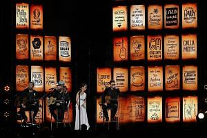 Brothers Osborne, Eric Church and Maren Morris performing a haunting version of Eric Clapton's ballad Tears In Heaven at the Grammy Awards.