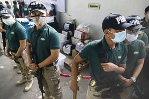 Philippine Drug Enforcement Agency officers guarding illegal drugs that have been seized, in Malabon City on Jan 25, 2018.