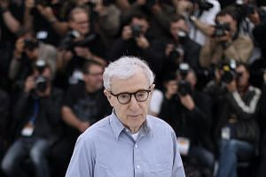 US director Woody Allen posing during a photocall ahead of the opening of the 69th Cannes Film Festival on May 11, 2016.