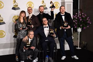 Portugal. The Man poses with their trophies for Best Pop Duo/Group Performance in the press room during the 60th Annual Grammy Awards in New York, US, on Jan 28, 2018.