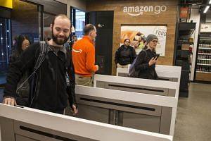Shoppers enter Amazon Go by scanning an app.