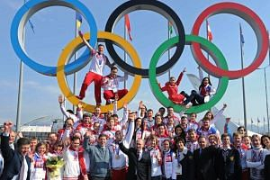 Russia's President Vladimir Putin posing for a photo with Russian athletes, winners of the Sochi 2014 Winter Olympics, in Sochi on Feb 24, 2014.