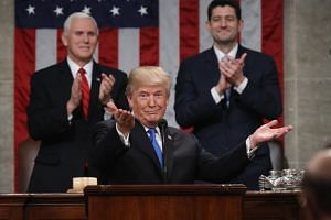 US President Donald Trump delivers the State of the Union address as US Vice President Mike Pence and Speaker of the US House of Representatives Paul Ryan look on.