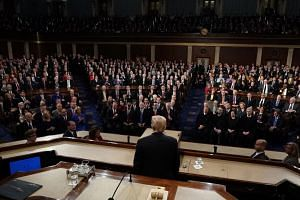 US President Donald Trump delivers his first State of the Union from the floor of the House of Representatives in Washington, DC.