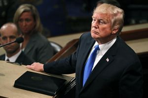 US President Donald Trump pauses as he delivers his State of the Union address to a joint session of the US Congress on Capitol Hill in Washington, DC.
