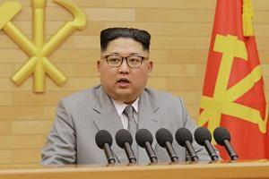 North Korea's leader Kim Jong Un giving a New Year's Day speech.
