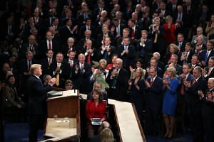 US President Donald Trump delivers the State of the Union address in the chamber of the US House of Representatives in Washington, DC.