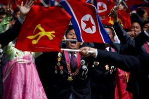 People react as they see Kim Jong Un during a military parade marking the 105th anniversary of North Korea's founding father Kim Il Sung's birth, in Pyongyang, North Korea, on April 15, 2017.