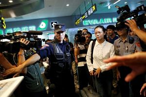 Li Ching-yu, the wife of Taiwan activist Li Ming-che, had bought a plane ticket on Xiamen Airlines, with plans to see her husband in prison.