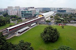 Aerial view of train at Tampines MRT Station.
