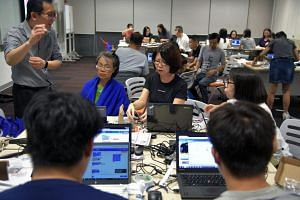 Participants attending a robotics workshop organised by SkillsFuture Singapore on Oct 28, 2017.