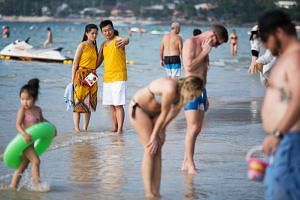 Tourists at Patong Beach in Phuket, Thailand on Jan 16, 2018.
