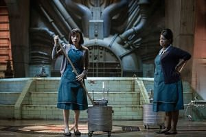 Cleaner Elisa (Sally Hawkins, left) and her friend Zelda (Octavia Spencer) work in a laboratory during the 1960s Cold War.