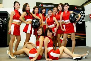Some of the grid girls for the Formula One Singapore Grand Prix in 2008.