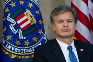 FBI director Christopher Wray attends his installation ceremony at FBI Headquarters in Washington, DC.