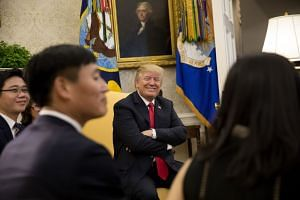 Trump meeting North Korean defectors in the Oval Office of the White House.
