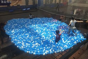 The ball pit is part of City Square Mall's three-storey Airzone, which has been touted as the world's first net playground built in a shopping centre atrium.