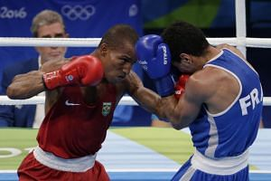 Robson Conceicao of Brazil in action against Sofiane Oumiha of France during the Rio 2016 Olympic Games men's light (60kg) final bout on Aug 16, 2016.