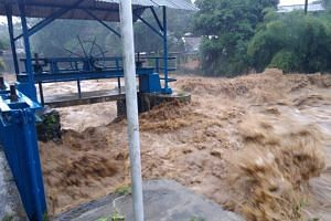 Indonesian authorities were forced to release water from a reservoir upstream in the city of Bogor as water levels prompted the highest alert.
