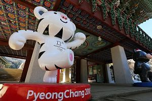 Mascots Soohorang (left) and Bandabi at the entrance of the Woljeongsa Temple in Pyeongchang. The Winter Olympics start on Friday but the International Olympic Committee has barred 15 Russians from competing.