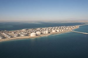 The tank farm for crude oil and refined products at the seaport of Ras Tanura in Saudi Arabia. The Middle Eastern kingdom has made its wealth from oil, but it is now making a push to diversify its economy, partly by moving into renewable energy.