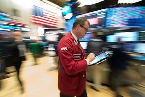 Traders work on the floor at the closing bell of the Dow Industrial Average at the New York Stock Exchange on Jan 30, 2018 in New York.