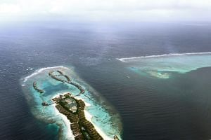 The Maldives has sought to reassure tourists they would be safe as governments warned their citizens to steer clear of the troubled honeymoon islands amid a spiralling political crisis.