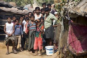 Rohingya refugees gather during a visit of Swiss Federal President Alain Berset at the Kutupalong refugee camp in Cox's Bazar, Bangladesh, on Feb 6, 2018.
