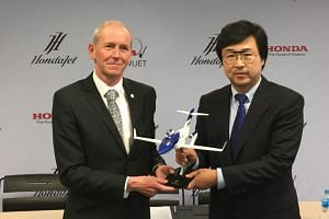 Patrick Hersent, chief executive of Wijet, and Mr Michimasa Fujino, chief executive of Hondajet during the signing of a 16-aircraft deal.