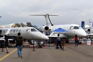 Embraer private jets are displayed during the SingaporeAirshow on Feb 7, 2018.