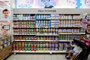 Rows of baby formula powder tins at a FairPrice Xtra supermarket.