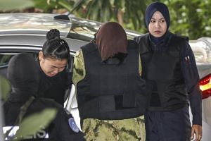 Vietnamese Doan Thi Huong and Indonesian Siti Aisyah, suspects in the murder of Kim Jong Nam, arrive at the Shah Alam High Court on Feb 9, 2018.