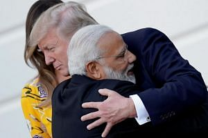 India's Prime Minister Narendra Modi hugs US President Donald Trump as he departs the White House after a visit on June 26, 2017.