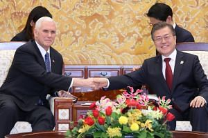Korean President Moon Jae In shakes hands with US Vice-President Mike Pence during their talks at the presidential office Cheong Wa Dae (Blue House) in Seoul on Feb 8, 2018.