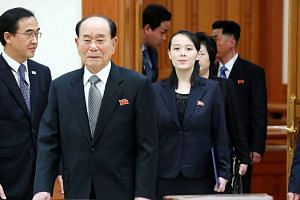 North Korean leader Kim Jong Un's sister, Kim Yo Jong, and North Korea's ceremonial head of state, Kim Yong Nam, arrive at a meeting room at the presidential Blue House in Seoul on Feb 10, 2018.