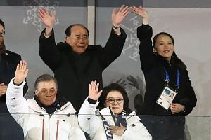 South Korean President Moon Jae In, his wife (both in front), North Korea's nominal head of state Kim Yong Nam and Ms Kim Yo Jong waving during the Winter Olympics opening ceremony in Pyeongchang, South Korea, yesterday. World leaders attended the op