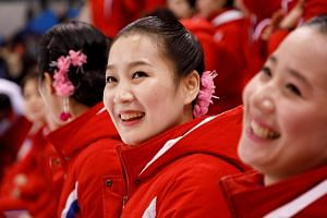 """Around 200 of North Korea's famed """"army of beauties"""" charmed a crowd of 3,600 besotted locals with nostalgic oldies."""