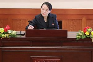 Ms Kim Yo Jong signs a guest book before a meeting with South Korean President Moon Jae In at the presidential Blue House in Seoul, on Feb 10, 2018.