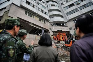 President Tsai Ing-wen (centre) inspecting search and rescue at a damaged building in Hualien, eastern Taiwan, on Feb 8, 2018.