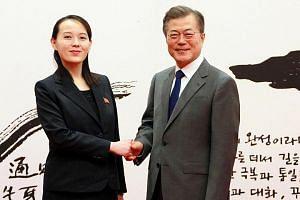 South Korean President Moon Jae In shakes hands with Kim Yo Jong, the sister of North Korea's leader Kim Jong Un, during a meeting in Seoul, South Korea.